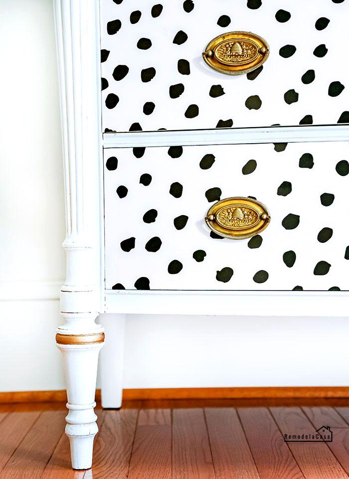 black hand-drawn-dots peel and stick wallpaper on dresser drawers