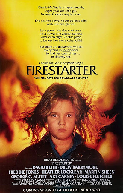 "Universal Pictures's ""Firestarter"" (1984) movie poster, starring Drew Barrymore, George C. Scott, Art Carney, Martin Sheen, David Keith, Heather Locklear, Freddie Jones, and Louise Fletcher"