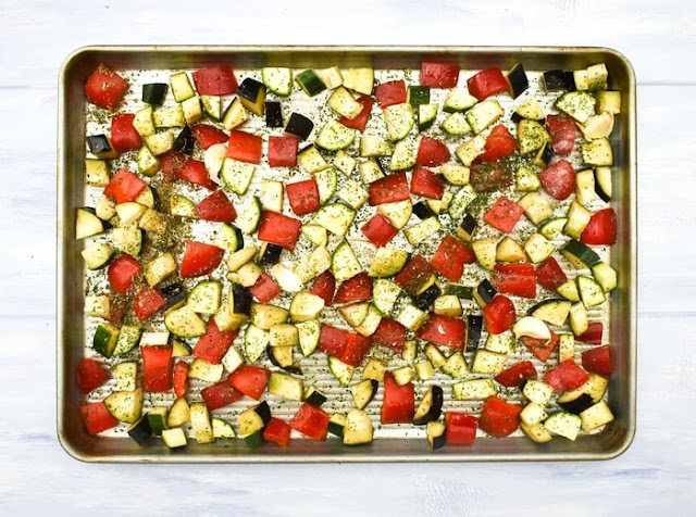 How to make ratatouille pasta - step - 2 - Herbs, seasoning & oil added to the vegetables