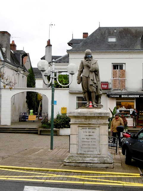 Statue of Descartes in his birth town, masked during Covid19 lockdown. Indre et Loire. France. Photo by Loire Valley Time Travel.