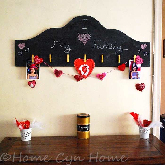 Dressing up a black board with felt hearts and a catchy quote makes for a great Valentine's themed decor in your home.