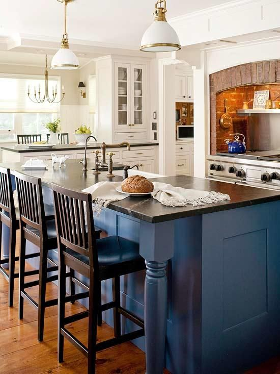 blue painted cabinets and black counter kitchen