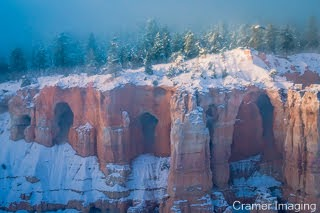 Cramer Imaging's fine art landscape photograph of dawn rising over magical fog the landscape of Bryce Canyon National Park, Utah