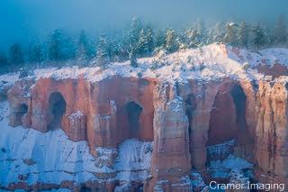 Cramer Imaging's fine art landscape photograph of dawn rising over magical fog the landscape of Bryce Canyon National Park, Utah