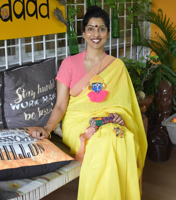 Army wife and recycling artist Reshma Kadvath wearing an up cycled necklace