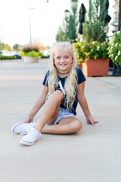 little girl outfit idea casual white sneakers abercrombie hairstyle braids pigtail buns