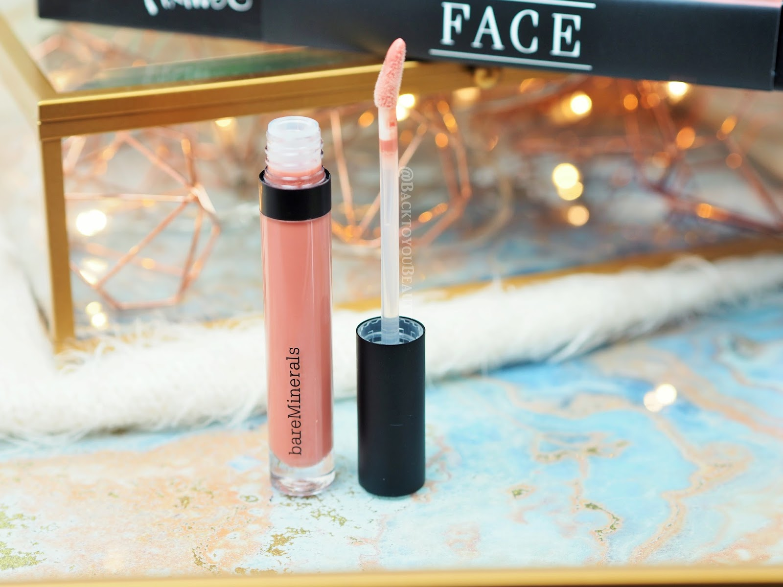 Moxie Plumping Lipgloss in shade Debutante