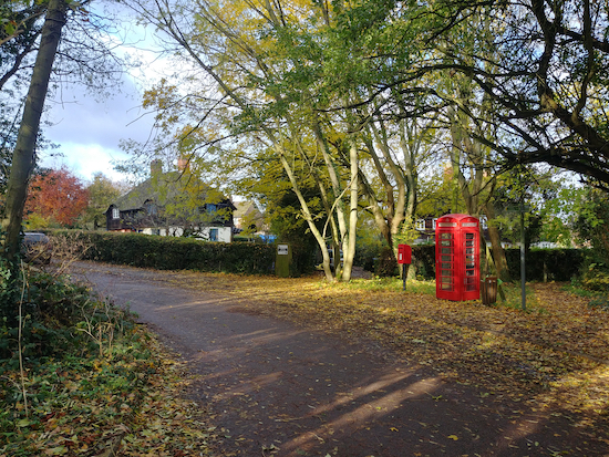 Turn left after the phone box and post box at the junction with Station Road Image by Hertfordshire Walker released via Creative Commons BY-NC-SA 4.0