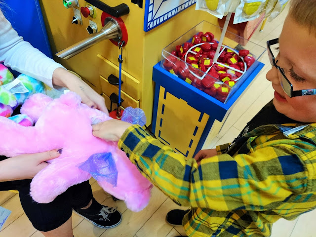 Dylan adding a special heart to Scarlet's Build a Bear. My Sunday Photo 22nd June 2018 on Us Two Plus You