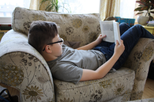 Boy reading in a chair