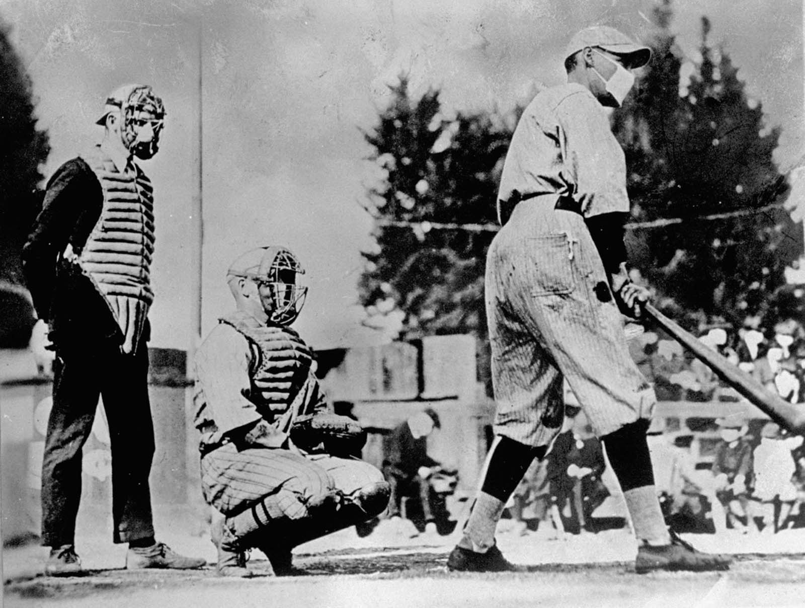 Baseball players wear masks to prevent the spread of infection during the influenza epidemic of 1918.
