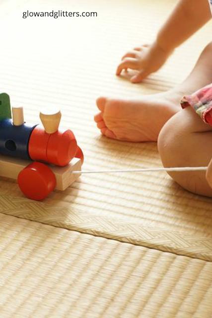 Nursery rugs and playing.