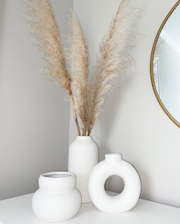 set of three white modern vases with dried pampas grass