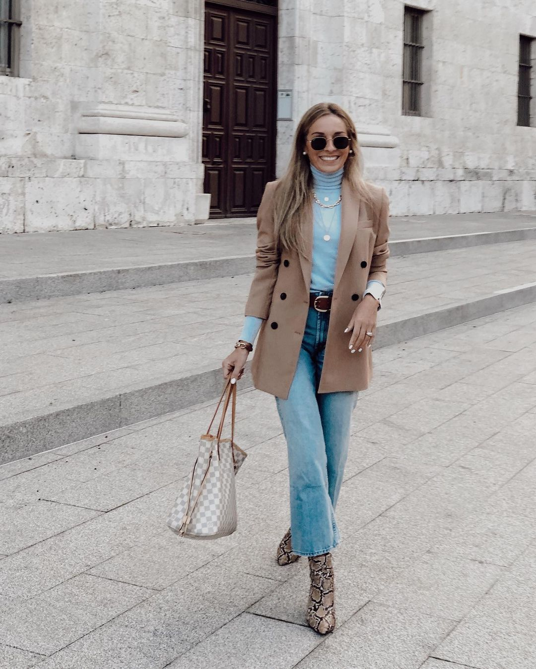 This Outfit Is Ready to Wear Anywhere —@virginiardgcasado Instagram look light blue turtleneck, tan blazer, wide-leg crop jeans, and snakeskin boots