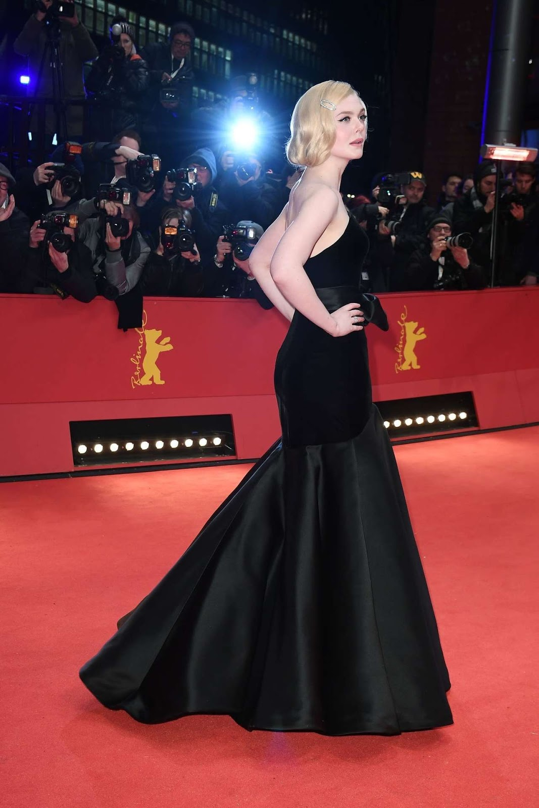 Elle Fanning flaunts slim figure at the 70th Berlinale Film Festival 'The Roads Not Taken' Premiere