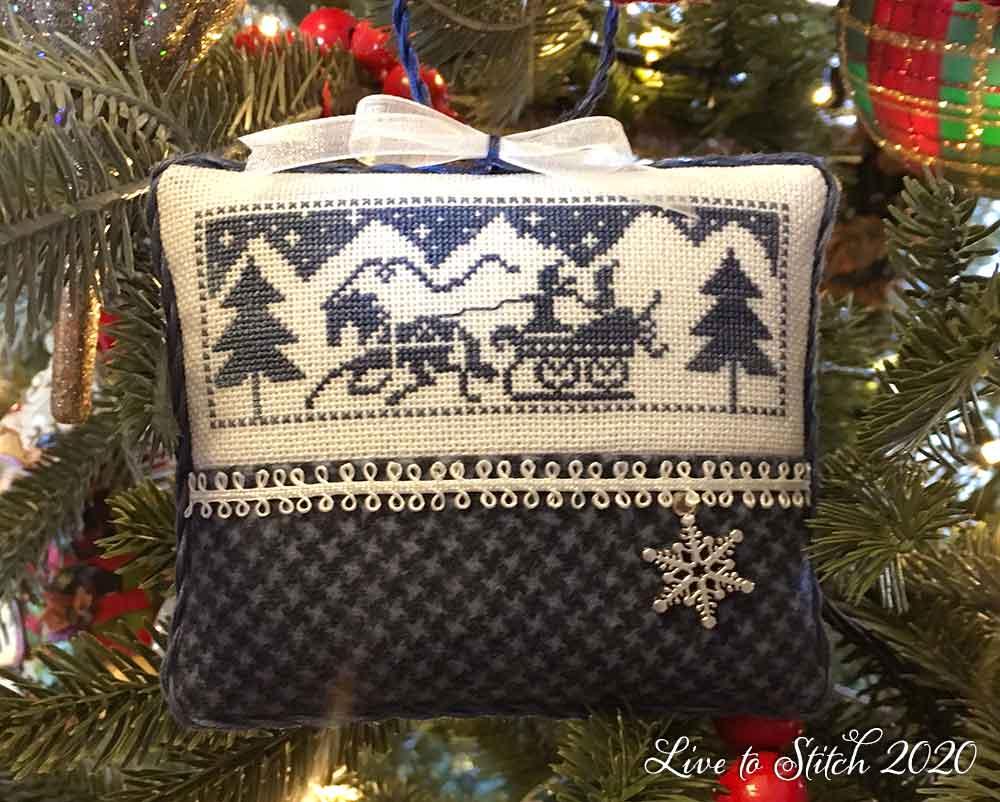 Nostalgic sleighing scene ornament