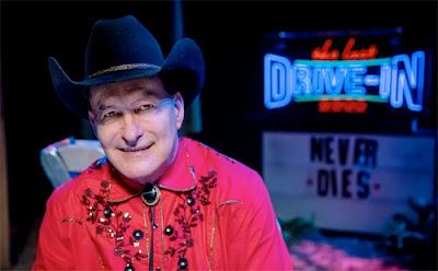 John Bloom as Joe Bob Briggs on the set of The Last Drive-in