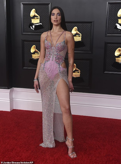Check out Dua Lipa as she strips down to her lingerie during racy performance at the 63rd Annual Grammy Awards (Photos)