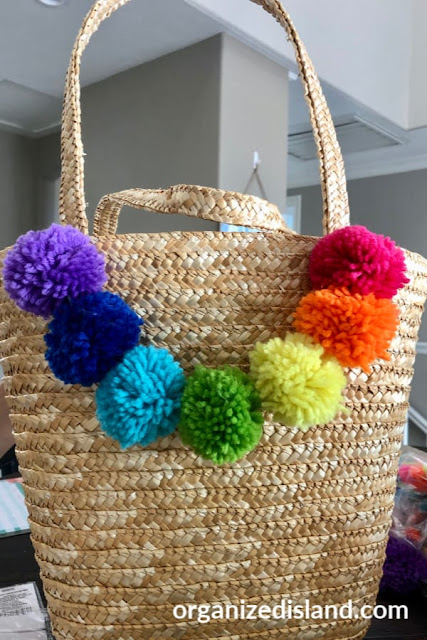 Fun and easy to make summer tote bag with rainbow colored pom poms.