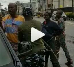 Policemen Deal With A Mopol For Beating A Pregnant Woman