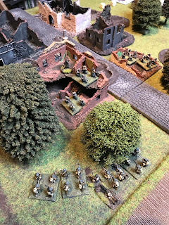 The British attackers get ready for an assault on the hamlet