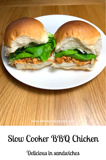 Soft white rolls filled with lettuce and BBQ chicken on a white plate