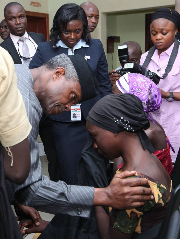 Photos: The moment VP Osinbajo and wife met 21 released Chibok girls