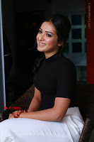 Actress Catherine Tresa Latest Stills in Black Top and White Pants  0007.JPG