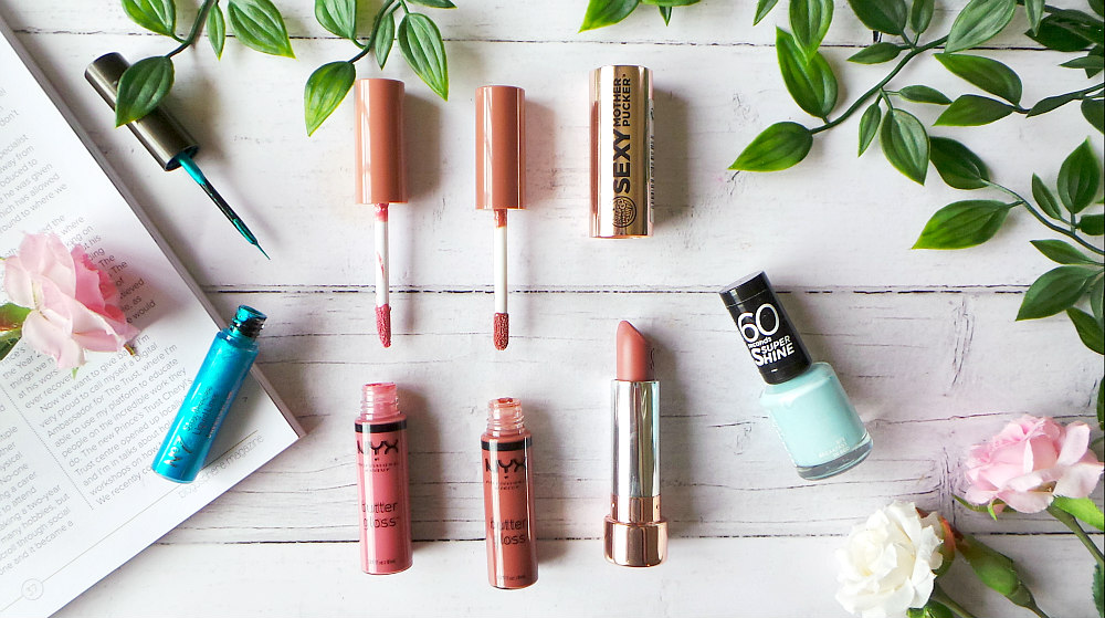 Image shows several open tubes. L-R turquoise No7 eyeliner, pink nude NYX lipgloss, brown NYX lipgloss, nude soap and glory lipstick and a light blue nail polish