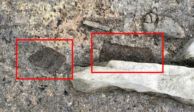 Το κομμάτι ξύλου (διακρίνεται στο κόκκινο πλαίσιο) αν και δεν είναι σε καλή κατάσταση θα προσφέρει σίγουρα πολυτιμές πληροφορίες στους ερευνητές. Φωτο: Sigurd Towrie / Ness of Brodgar Excavation