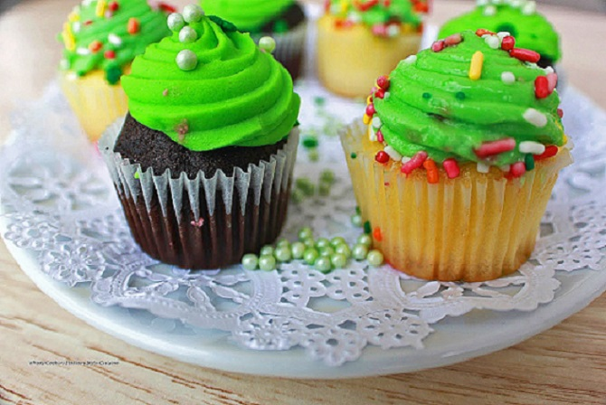 Chocolate stout cupcakes with green frosting and vanilla on a plate
