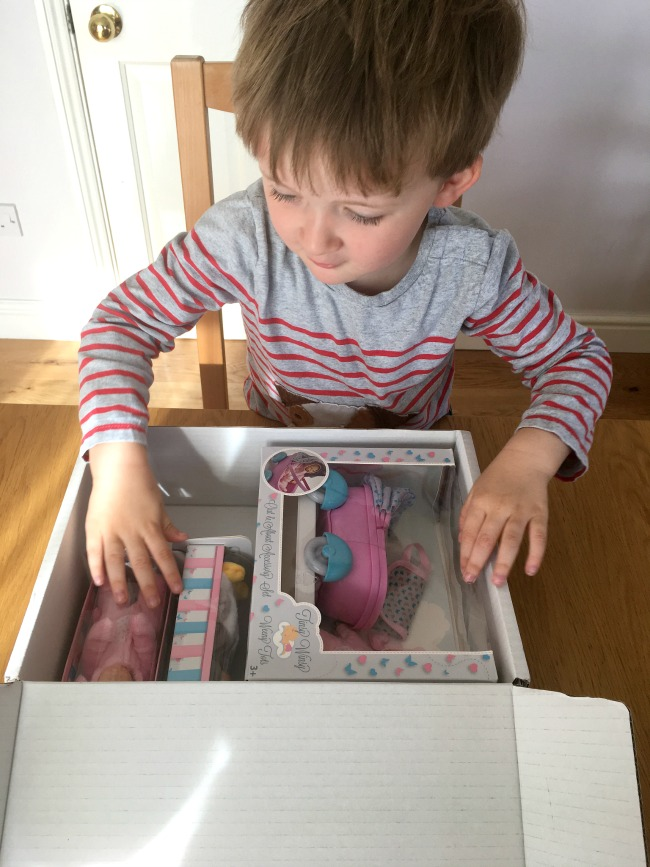 boy-opening-box-containing-Tinsy-winsy-weeny-tot-dolls-and-pram-set