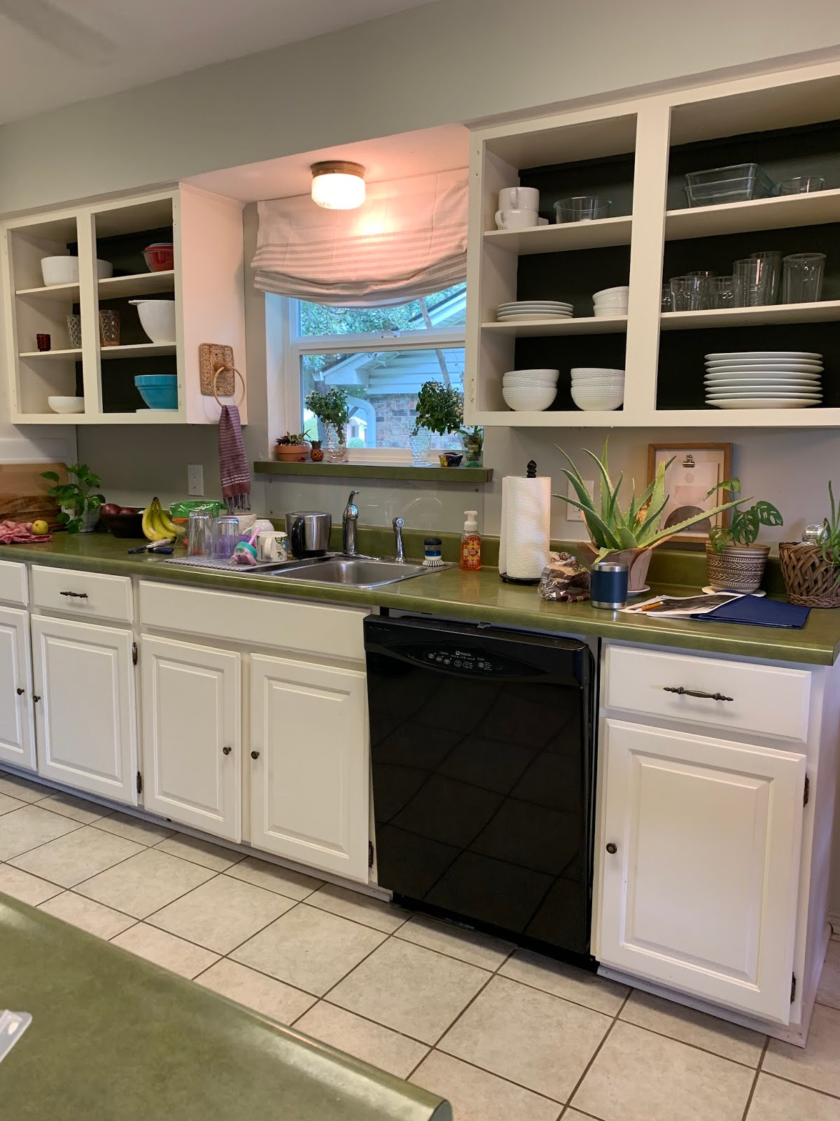one room challange before: remove cabinet doors or open shelving, green countertops, paint over wallpaper, galley kitchen