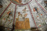 "A detail of the restored fresco of ""dei Fornai"" (bakers) cubicle, is pictured during a visit after the restoration of the catacomb of Santa Domitilla, in central Rome, on May 30, 2017 [Credit: AFP/Andreas Solaro]"