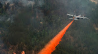 A US Air Force C-130 Hercules sprays retardant on a wildfire in Waldo Canyon, Colorado (Photo Credit: Staff Sgt. Stephany Richards/US Air Force) Click to Enlarge.