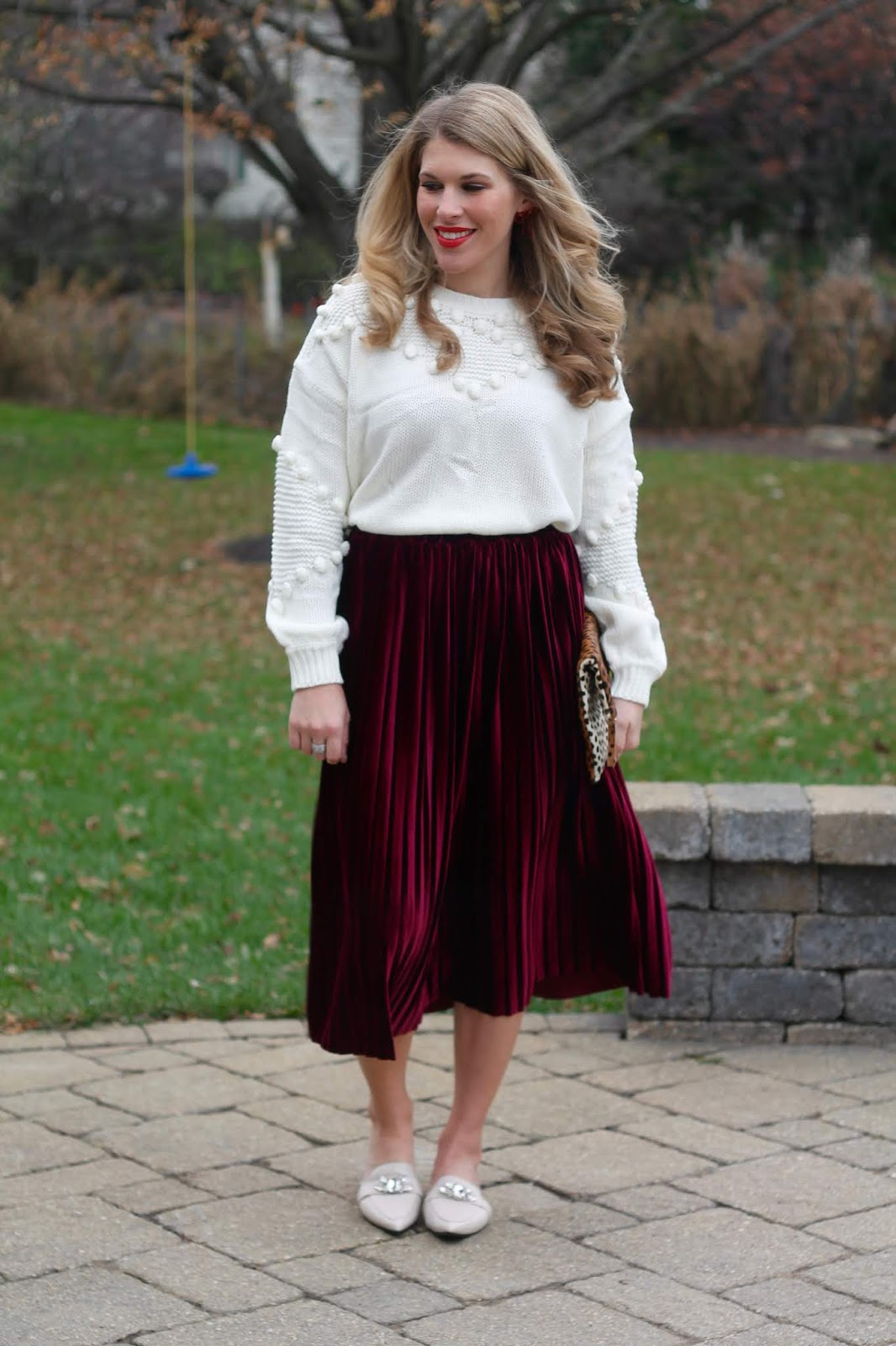 burgundy velvet skirt outfit, white pom pom sweater, jeweled mules, leopard clutch, sugarfix bow earrings, holiday outfit, christmas outfit
