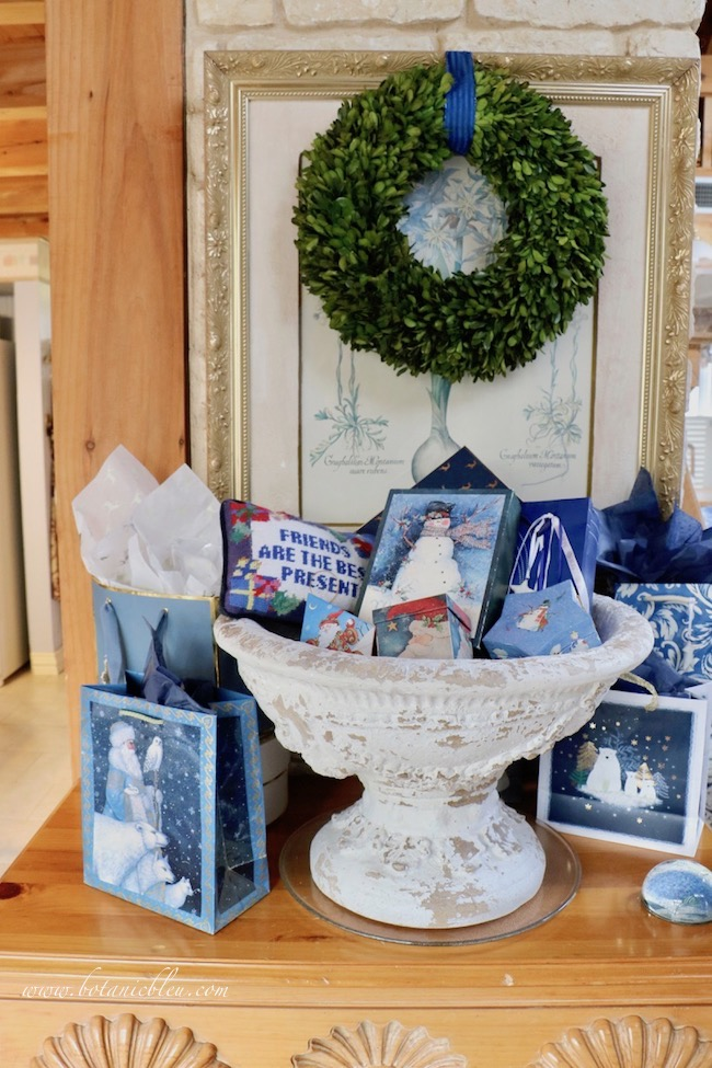 French country blue Christmas presents wrapped in decorated stationery boxes and candy boxes