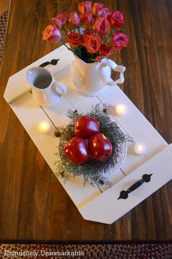 Christmas Tray Display with apples, flowers and votive candles