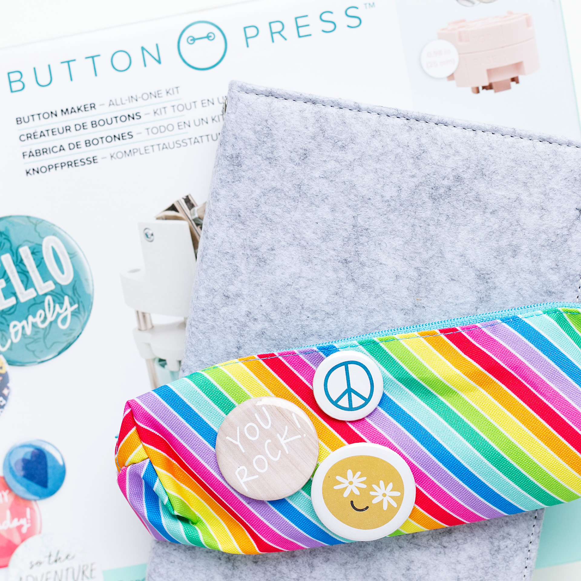 The Button Press packaging with a colorful and fun pencil case with flair buttons