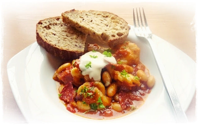 white fish, white beans, chorizo in a tomato sauce spiked with chipotle peppers