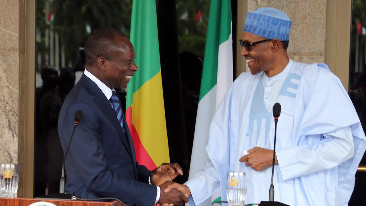 Buhari holds bilateral talks with President Talon 1