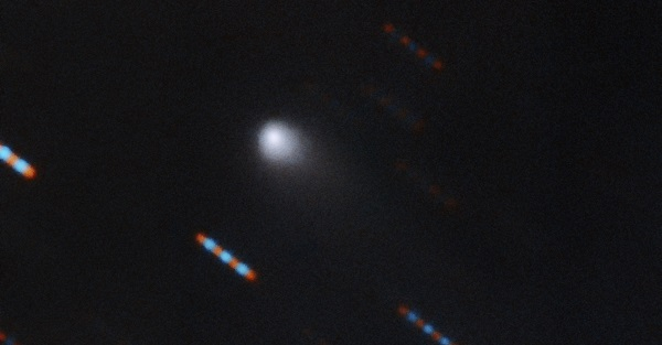Gemini Observatory two-color composite image of C/2019 Q4 (Borisov) which is the first interstellar comet ever identified. This image was obtained using the Gemini North Multi-Object Spectrograph (GMOS) from Hawaii's Maunakea. The image was obtained with four 60-second exposures in bands (filters) r and g. Blue and red dashes are images of background stars which appear to streak due to the motion of the comet. Composite image by Travis Rector.  Image Credit: Gemini Observatory/NSF/AURA