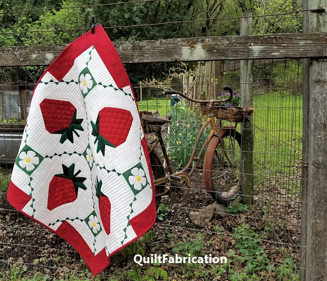 Strawberry Splendor quilted wall hanging