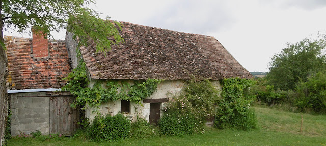 Old farm cottage.  Indre et Loire, France. Photographed by Susan Walter. Tour the Loire Valley with a classic car and a private guide.