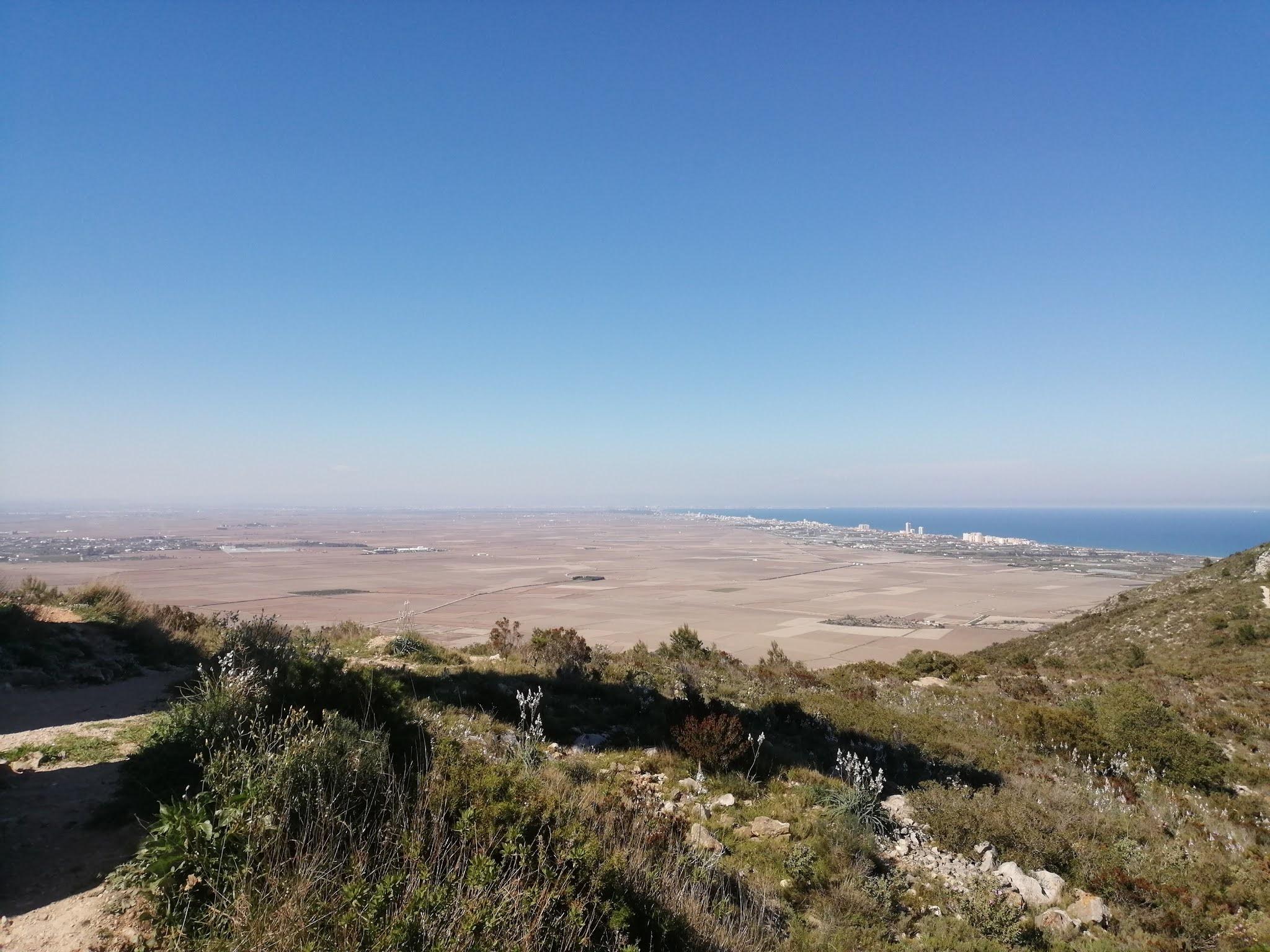 View north from la Bola de Cullera across the Albufera rice fields towards the city of Valencia