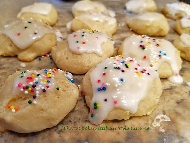 these are frosted white cookies made with ricotta cheese and sprinkles on top