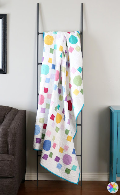 """Spot On quilt pattern by Andy of A Bright Corner - precut friendly using 10"""" squares (layer cake) and the pattern has four sizes: crib, throw, twin, queen"""