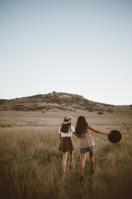 friends hiking in countryside, unsplash.com