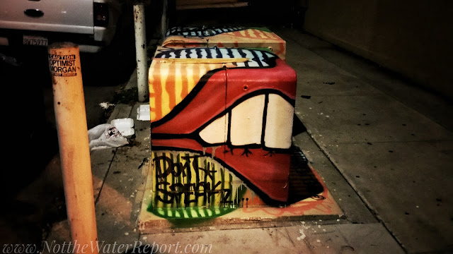 A red lipped mouth painted onto an electrical Box.