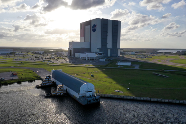 With the Space Launch System's core stage booster for Artemis 1 onboard, NASA's Pegagus barge docks at Kennedy Space Center's turn basin wharf...on April 27, 2021.